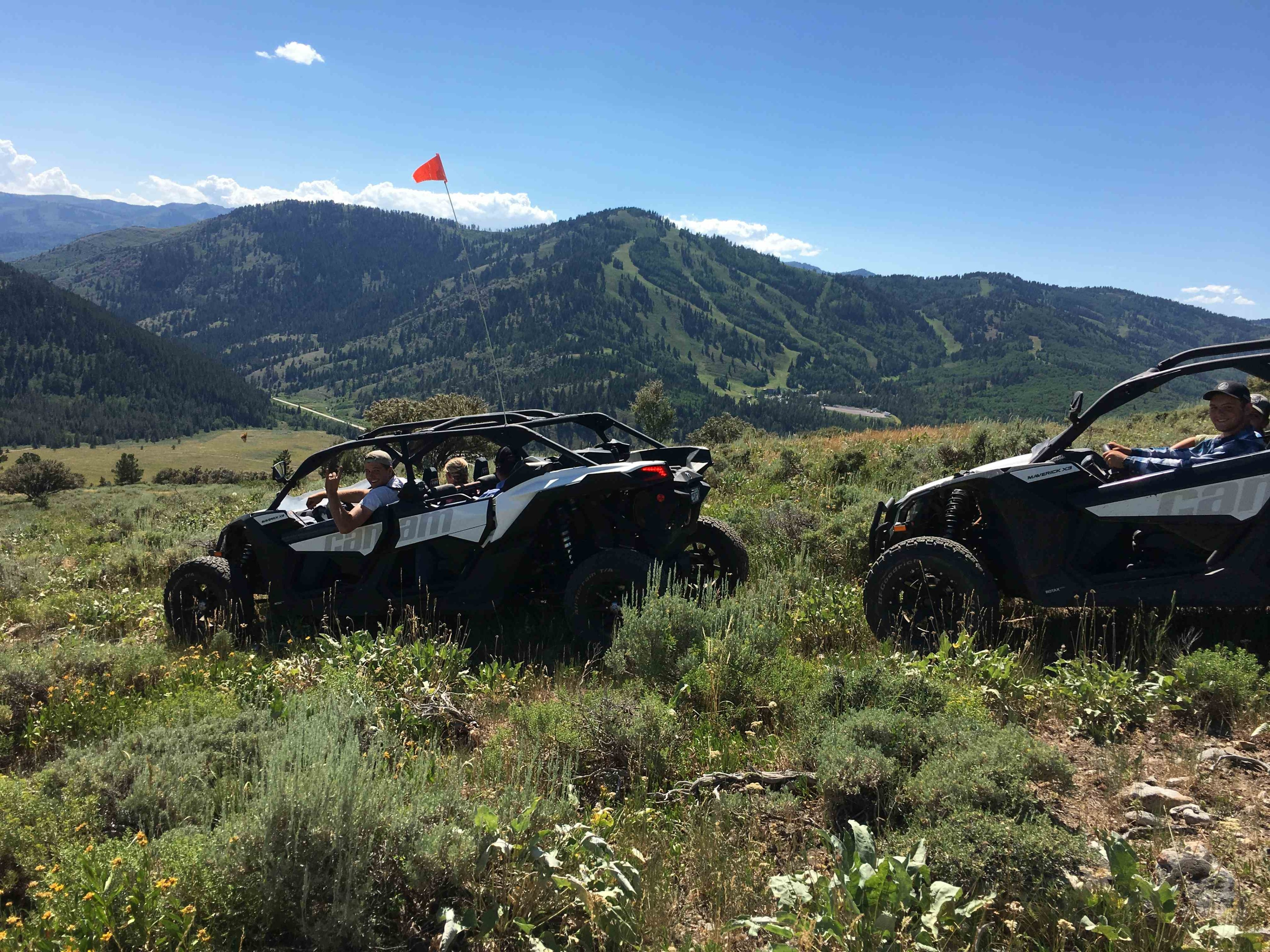 2 Maverick X3 with mountains in background